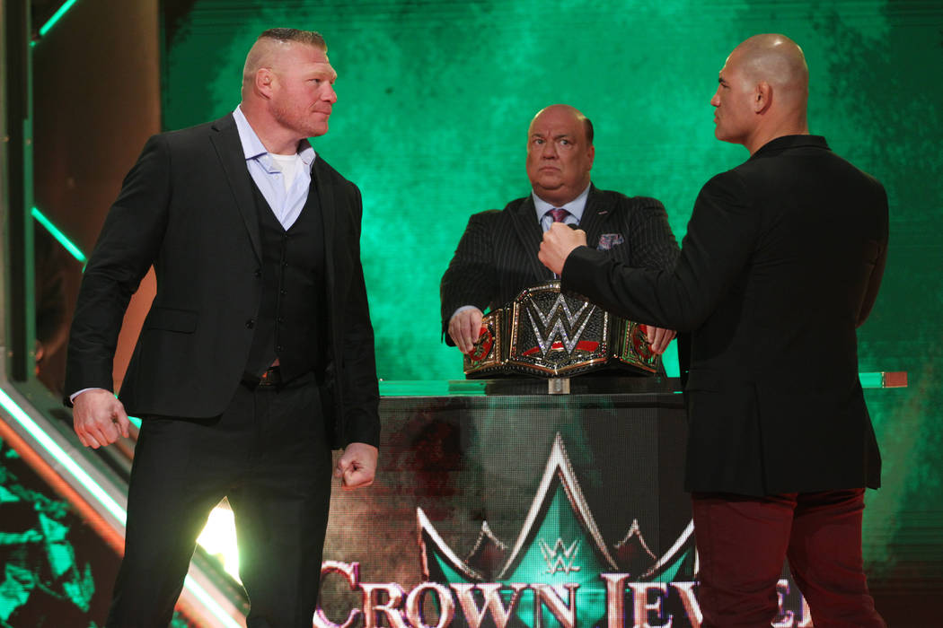 Brock Lesnar, left, with Cain Velasquez, pose during a World Wrestling Entertainment press conf ...