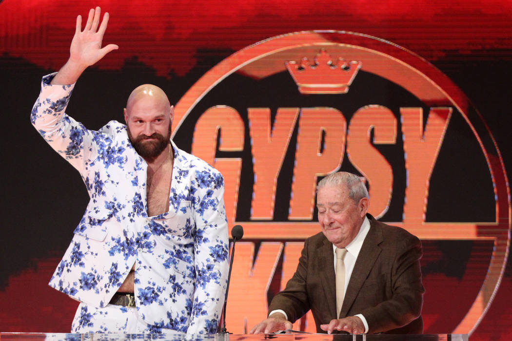 Boxer Tyson Fury, left, with Top Rank boxing CEO Bob Arum, during a World Wrestling Entertainme ...