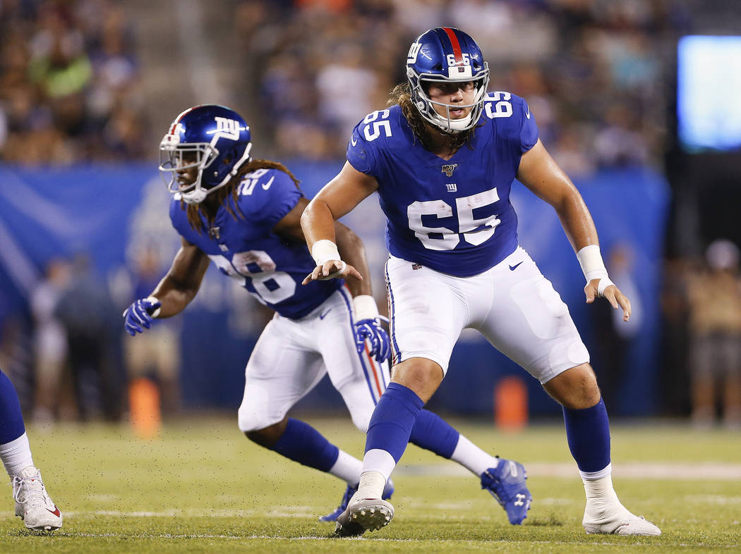 New York Giants offensive guard Nick Gates (65) looks to block during the second quarter of a p ...