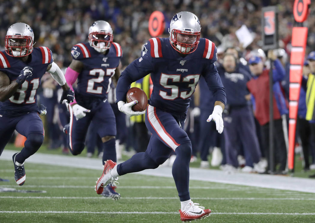 New England Patriots linebacker Kyle Van Noy runs for a touchdown after recovering a New York G ...
