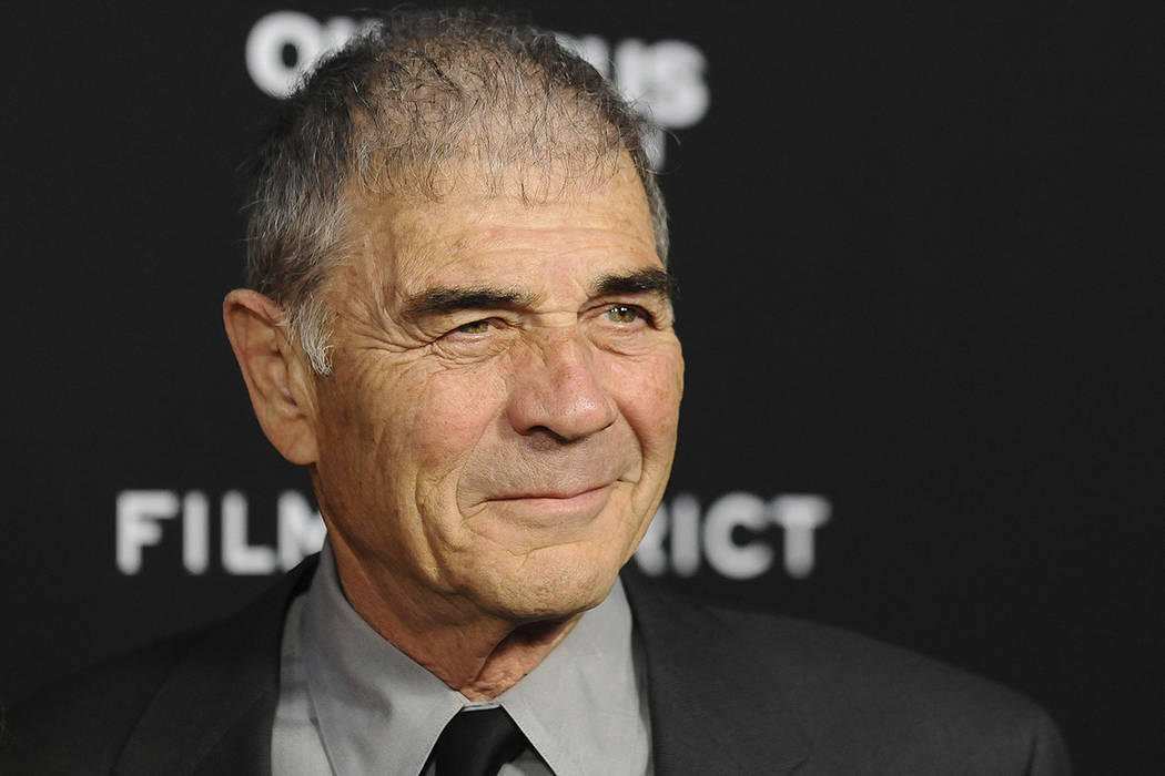 """In this Monday, March 18, 2013 file photo, Robert Forster arrives at the LA premiere of """"Olympu ..."""