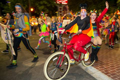 Tandem bicyclists riding in the Pride parade on Friday, Oct. 11, 2019 in Las Vegas. (L.E. Basko ...