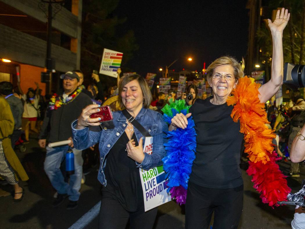Democratic presidential candidate Sen. Elizabeth Warren, D-Mass., marching in the Pride parade ...