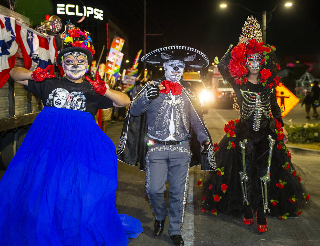 Participants dressed in Day of the Dead costumes march during the annual Las Vegas Pride Night ...