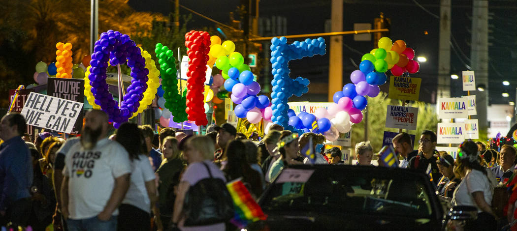 Participants stage on Gass Avenue before marching during the annual Las Vegas Pride Night Parad ...