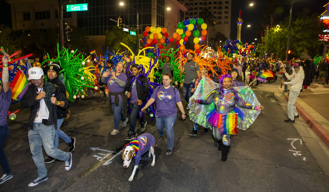 Participants move up S. Fourth Street during the annual Las Vegas Pride Night Parade on Friday, ...