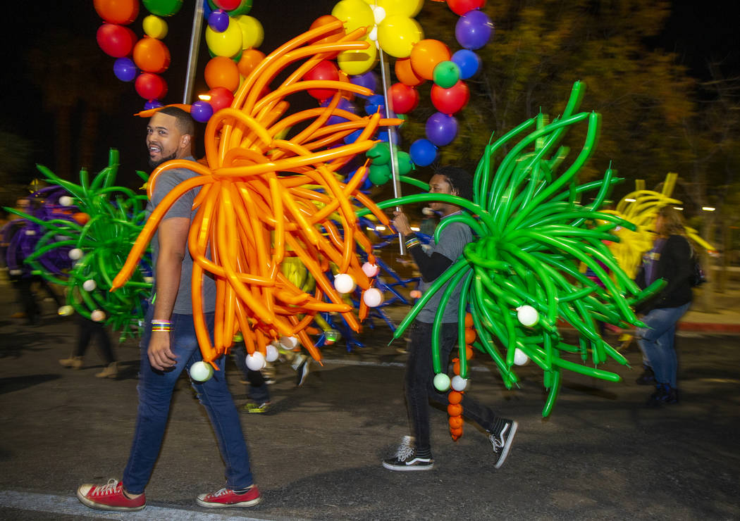 Participants in balloon costumes move up S. Fourth Street during the annual Las Vegas Pride Nig ...