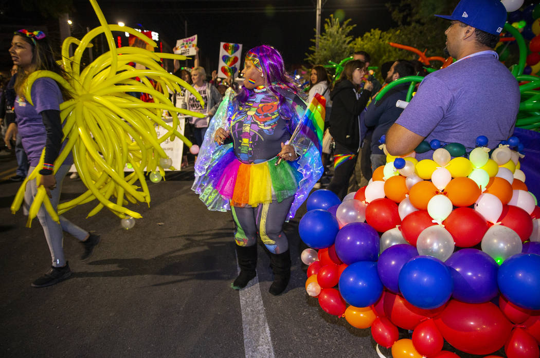 Participants in costumes march up S. Fourth Street during the annual Las Vegas Pride Night Para ...