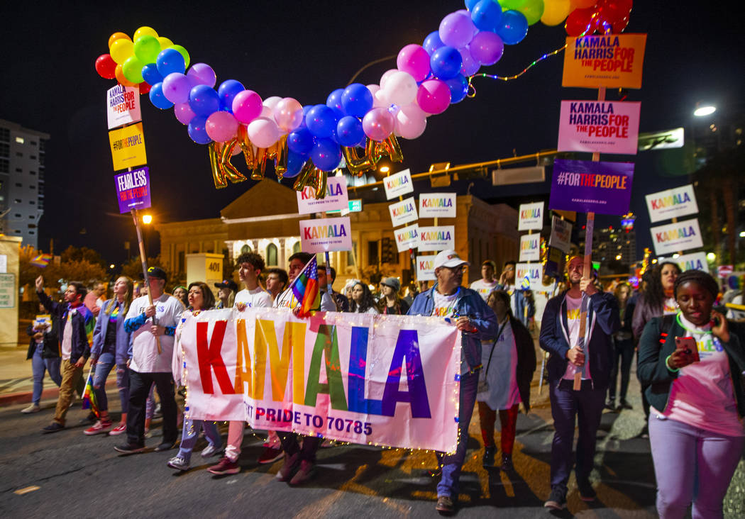 Supporters of Democratic presidential candidate Sen. Kamala Harris, D-Calif., march up S. Fourt ...