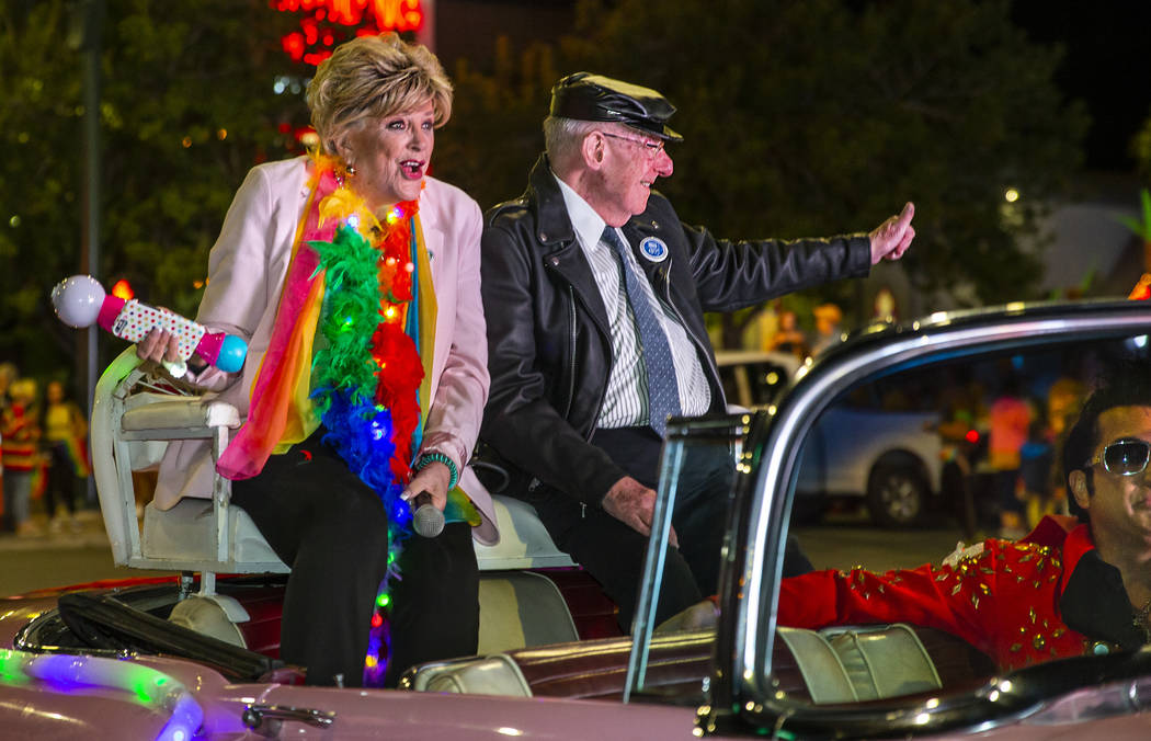Mayor Carolyn Goodman and her husband, Oscar, ride up S. Fourth Street during the annual Las Ve ...