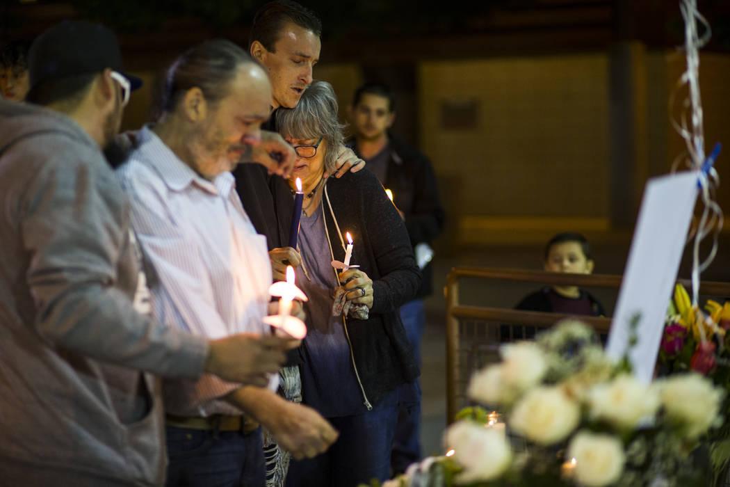 Chuck Wheeler, second from left, mourns his grandson, Gavin Murray Palmer, alongside Sean Murra ...