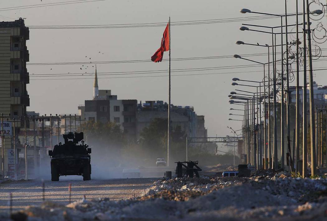 A Turkish police armored vehicle patrols the town of Akcakale, Sanliurfa province, southeastern ...