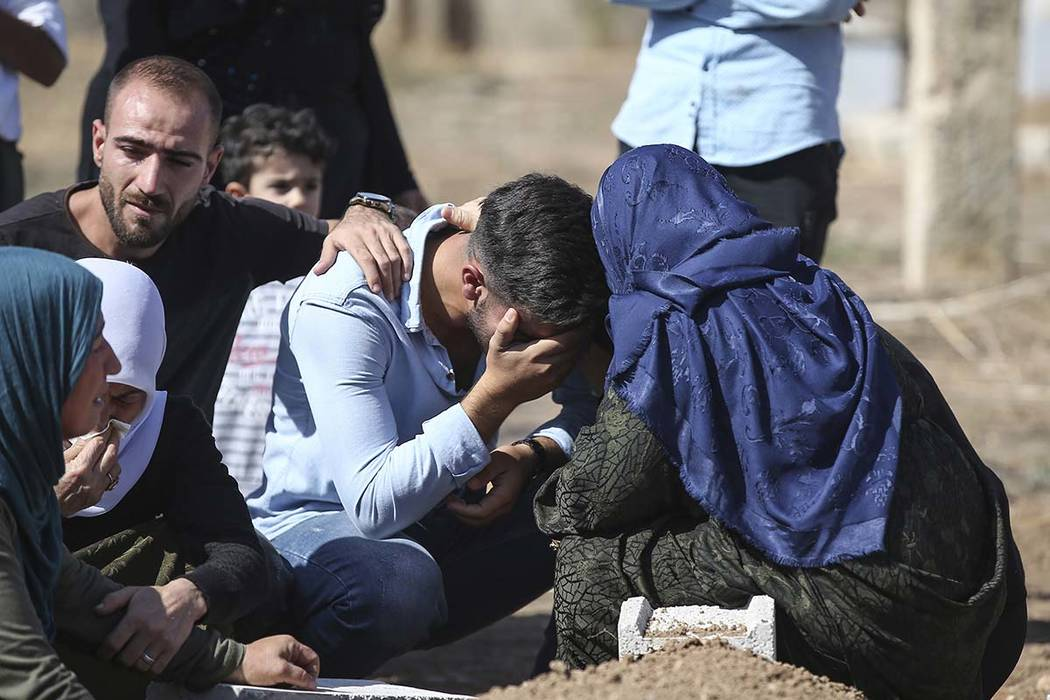 Relatives of Halil Yagmur, 64, who was killed Friday during mortar shelling from Syria, mourn o ...