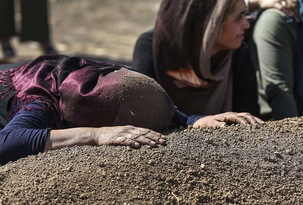 Family members of Halil Yagmur, 64, killed Friday during mortar shelling from Syria, cry over h ...