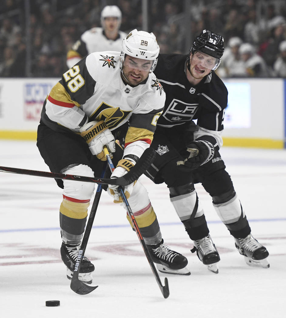 Vegas Golden Knights left wing William Carrier, left, and Los Angeles Kings left wing Austin Wa ...