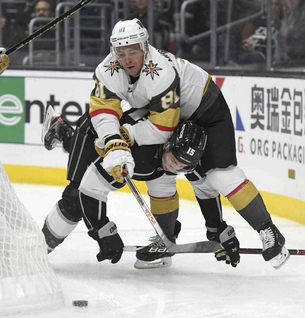 Vegas Golden Knights center Jonathan Marchessault, top, smothers Los Angeles Kings defenseman B ...