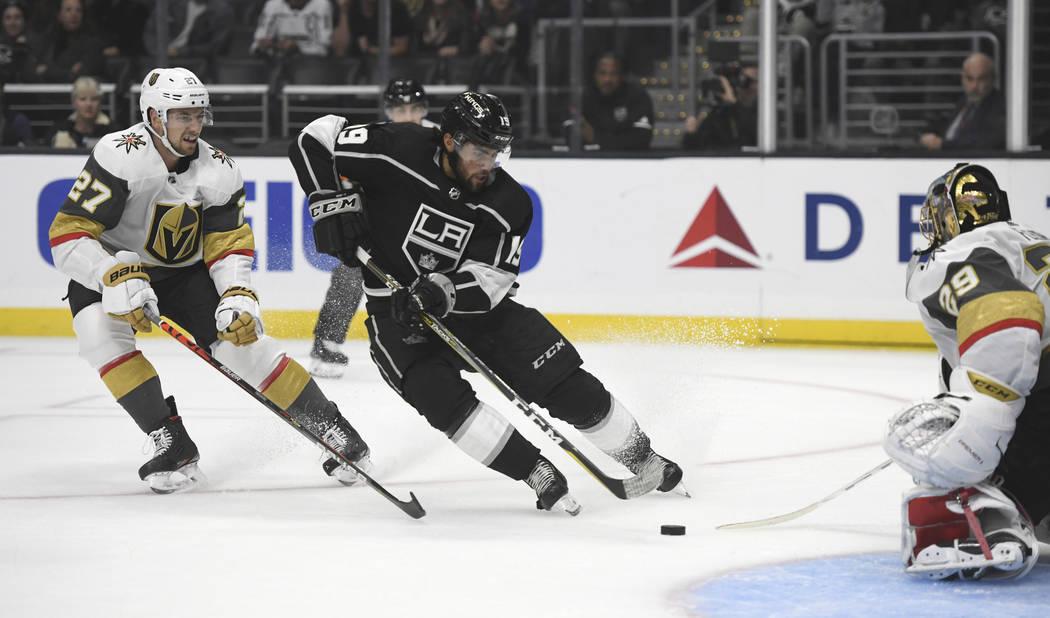 Los Angeles Kings center Alex Iafallo, center, shoots against Vegas Golden Knights goalie Marc- ...