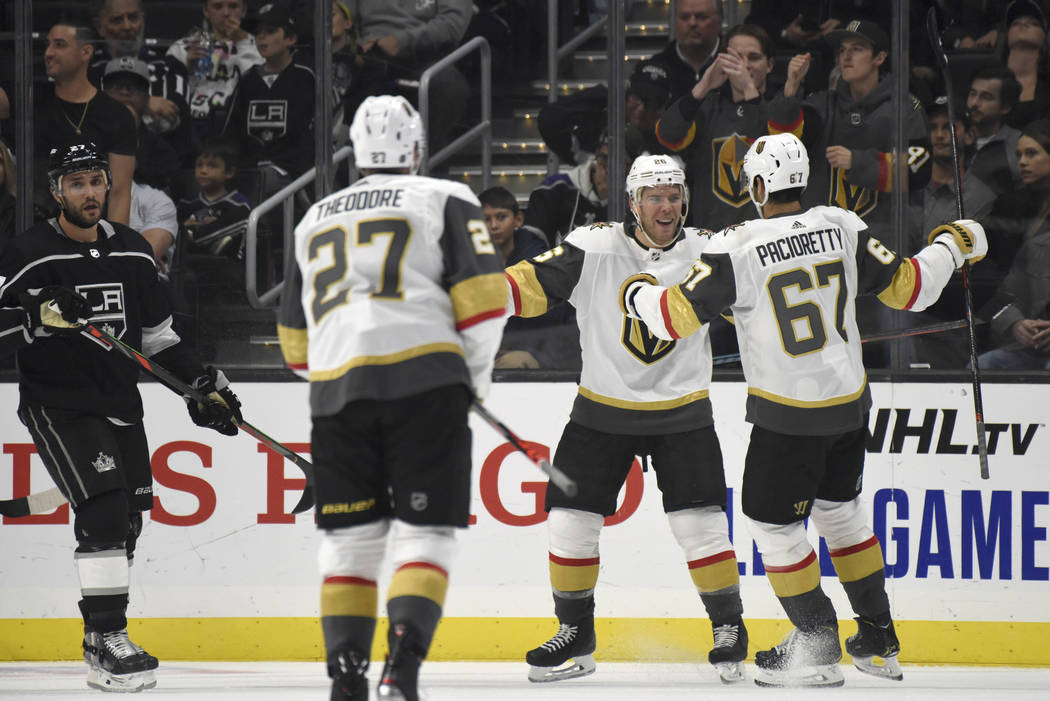 Vegas Golden Knights center Paul Stastny, center, is congratulated after scoring against the Lo ...