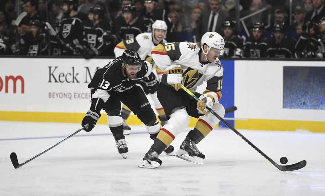 Vegas Golden Knights defenseman Jon Merrill attempts to clear the puck as Los Angeles Kings lef ...