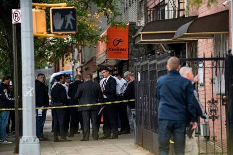 NYPD investigates the scene of a shooting in the Brooklyn borough of New York on Saturday, Oct. ...