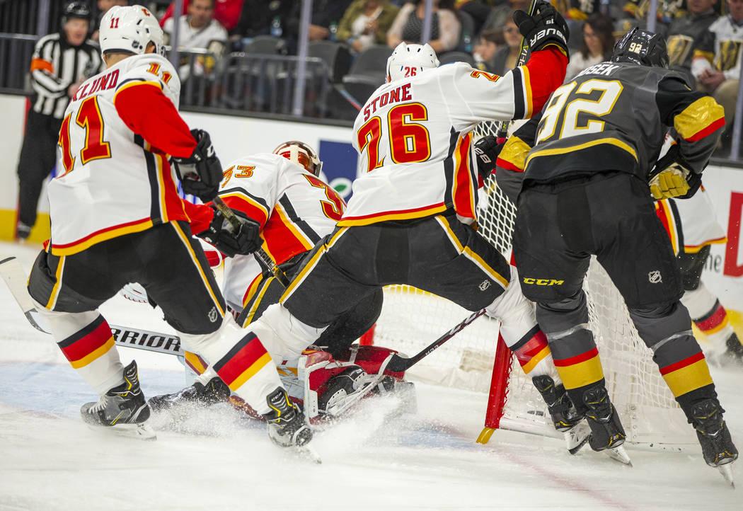 Vegas Golden Knights left wing Tomas Nosek (92) sneaks a goal in behind Calgary Flames goaltend ...