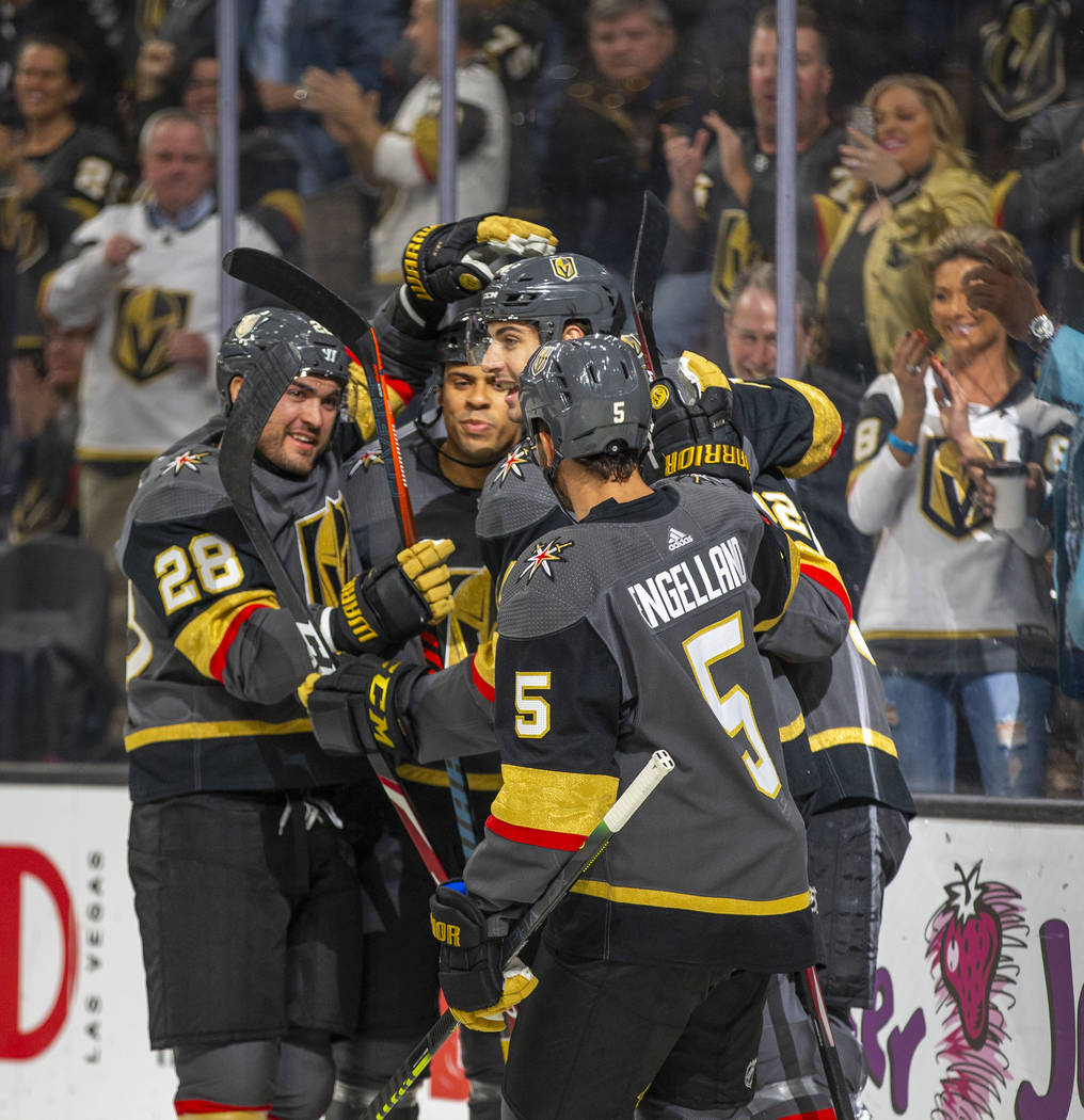 Vegas Golden Knights left wing Tomas Nosek (92, center) is congratulated by teammates after sco ...