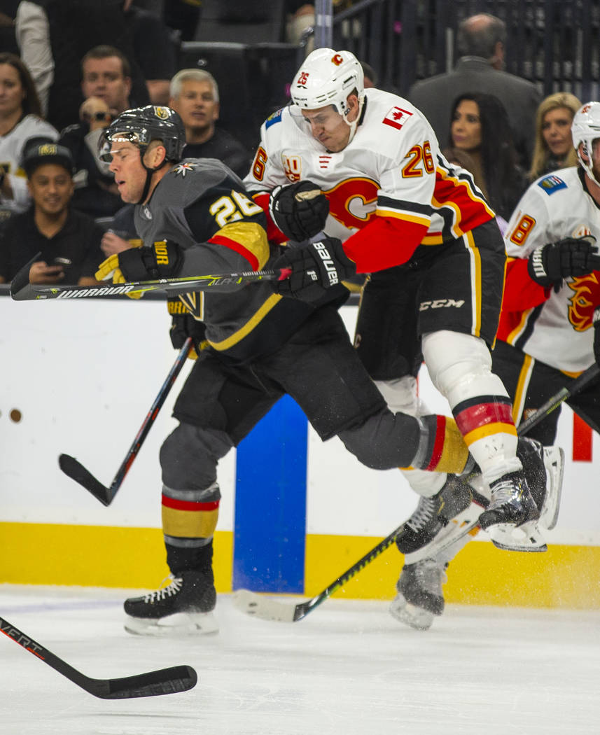 Vegas Golden Knights center Paul Stastny (26) collides with Calgary Flames defenseman Michael S ...