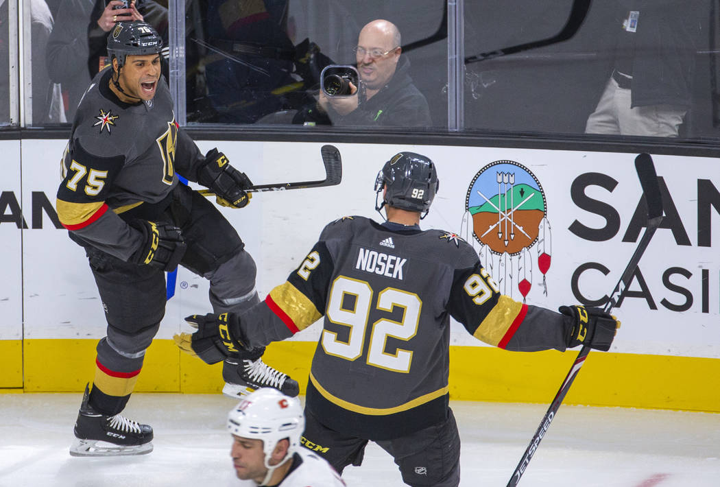 Vegas Golden Knights right wing Ryan Reaves (75) celebrates his first goal of the season with l ...