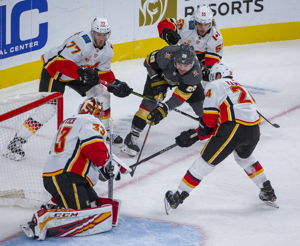 Vegas Golden Knights left wing William Carrier (28) penetrates the defense and shoots on Calgar ...