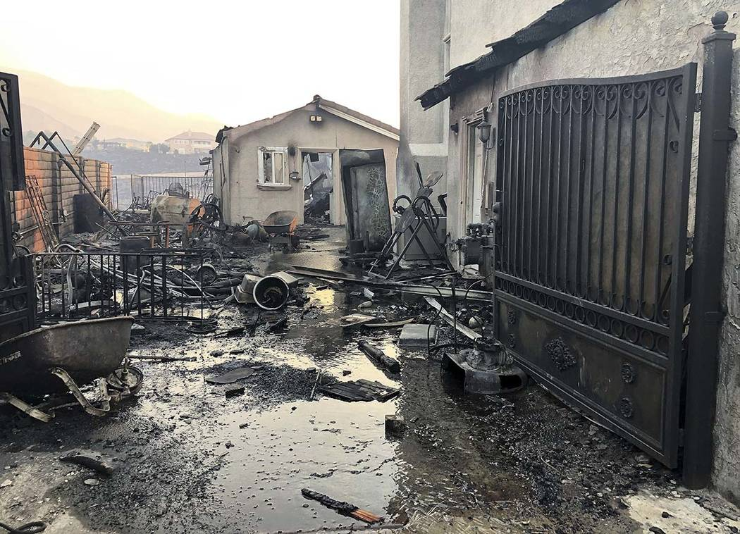 Santa Ana wind driven flames destroyed this home on Beaufait Ave. in Porter Ranch, Calif,. on F ...