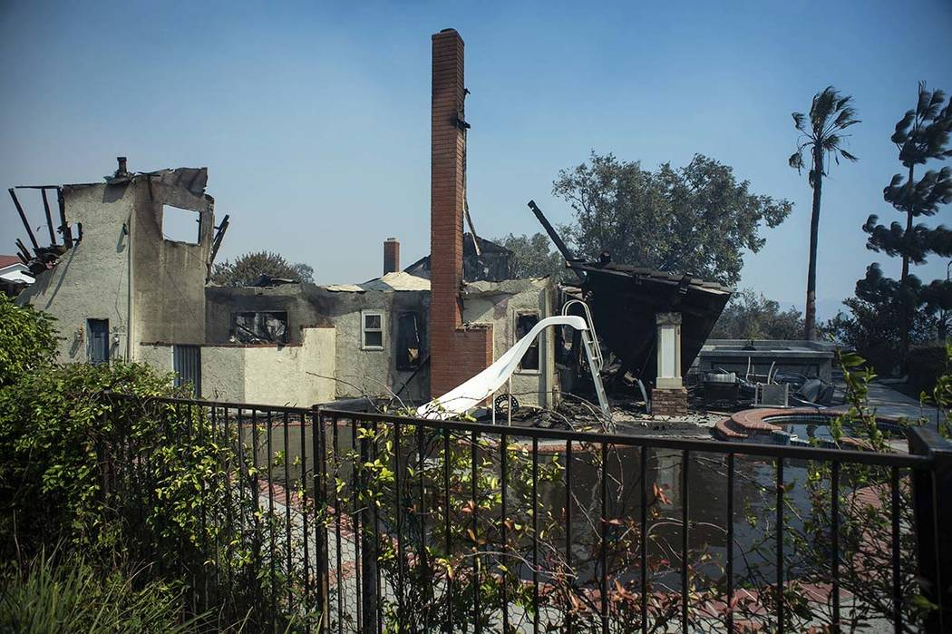 The Manokian home on Hampton Court in the Porter Ranch area of Los Angeles is seen after it bur ...