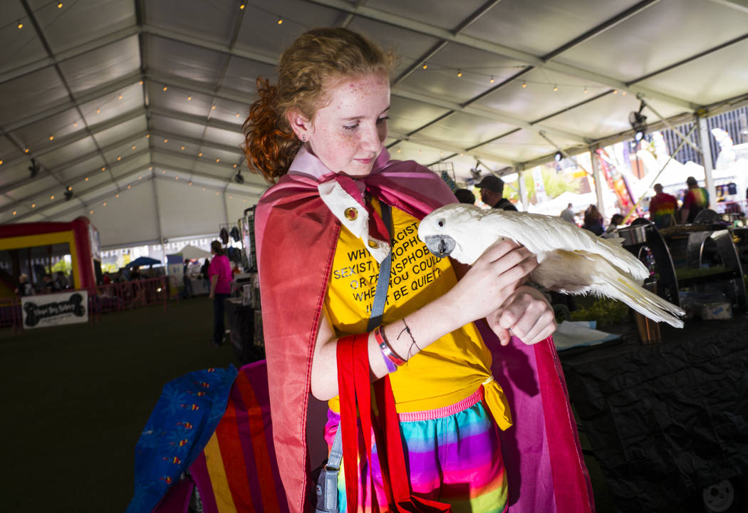 Twelve-year-old Marly Black, of Henderson, holds Coco Puff, an umbrella cockatoo, at the SouthW ...