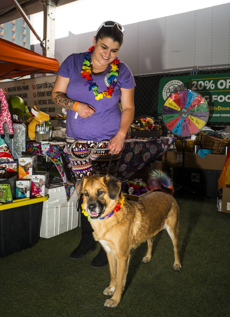 Chloe Kelly, of Dog Food 2 Go, poses with Oakleigh at the Pride Pets area of the Las Vegas Prid ...