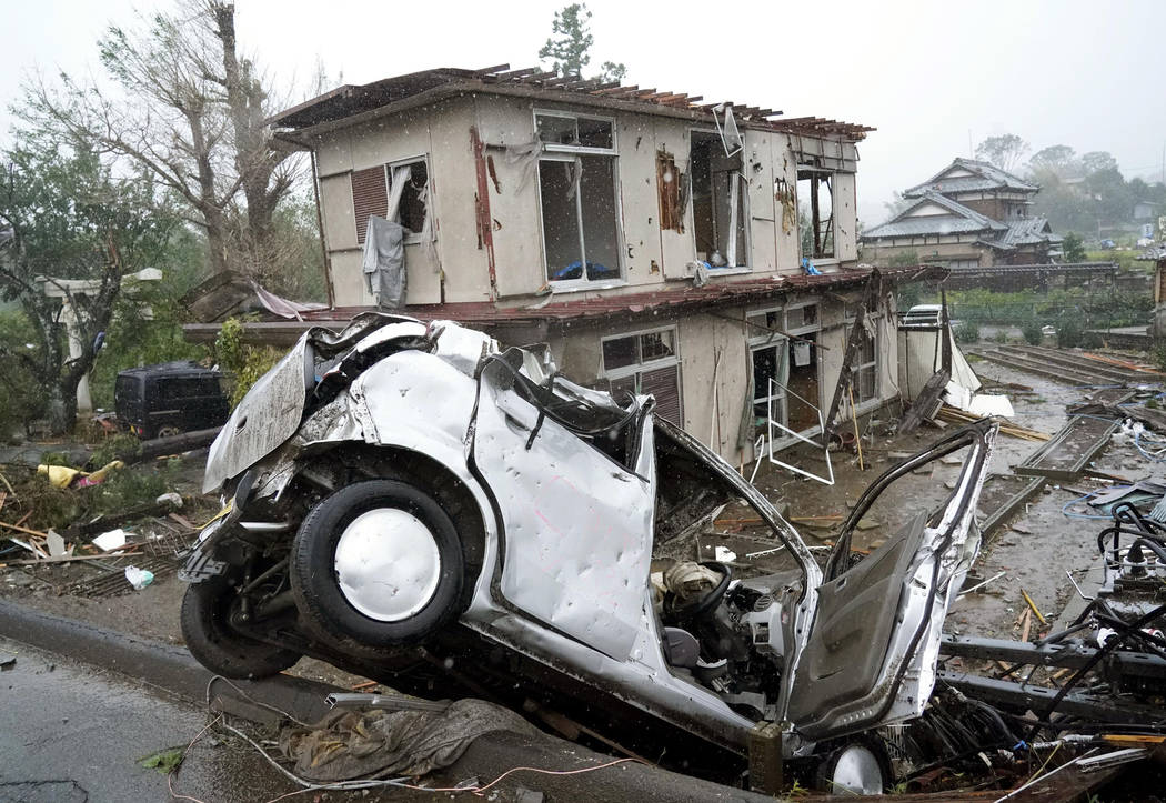 Destroyed house and vehicle are seen following a strong wind in Ichihara, Chiba, near Tokyo Sat ...