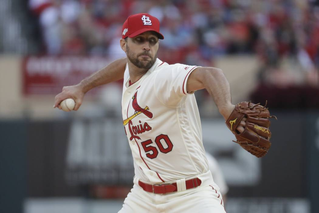 St. Louis Cardinals starting pitcher Adam Wainwright throws during the fourth inning of Game 2 ...