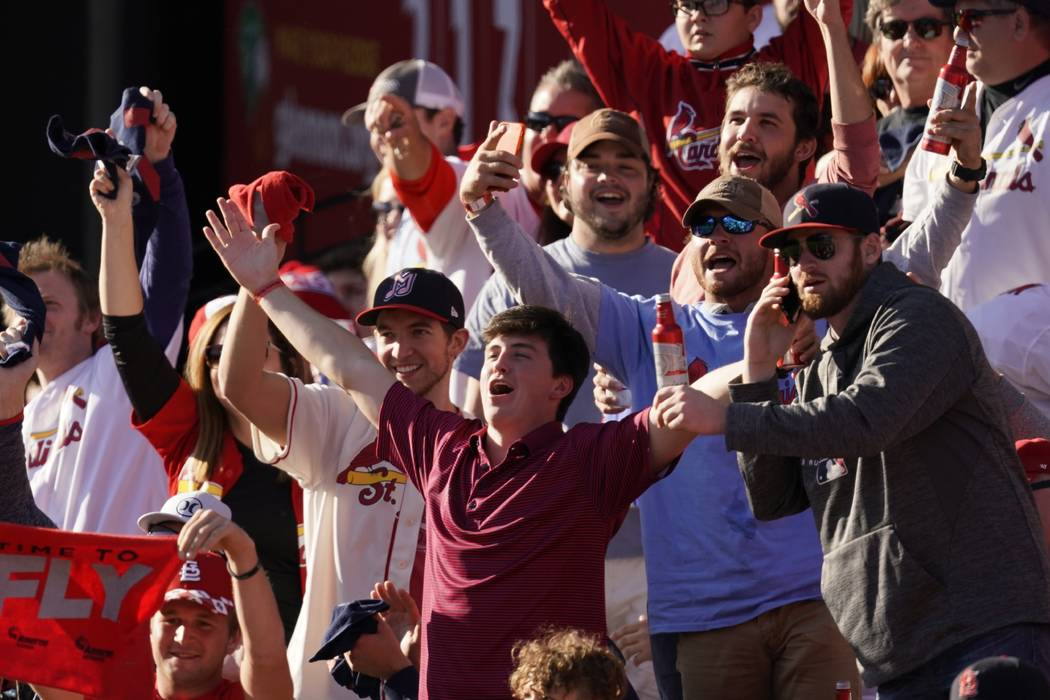 Fans cheer during the fifth inning of Game 2 of the baseball National League Championship Serie ...