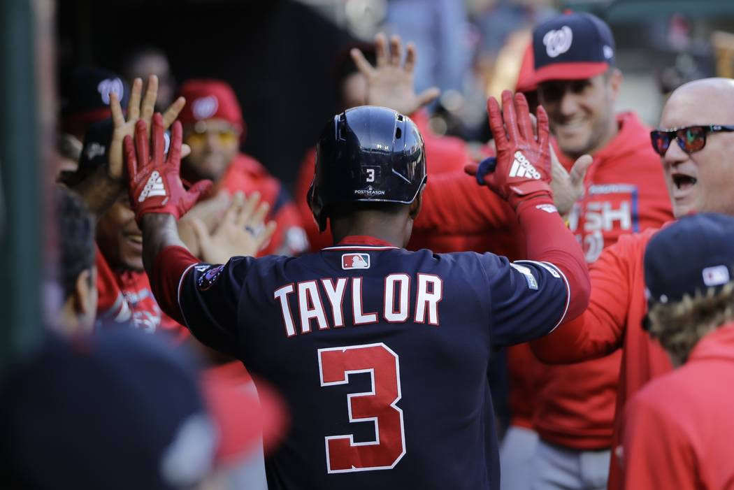Washington Nationals' Michael A. Taylor is congratulated after hitting a home run during the th ...