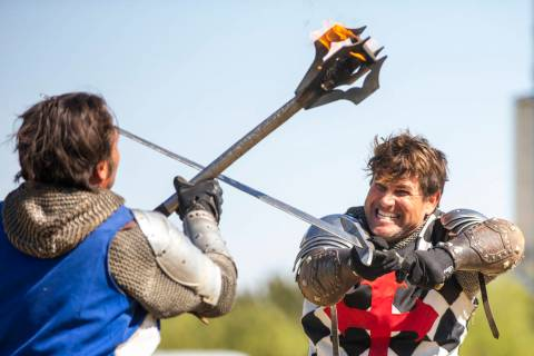 Arms clash as Sir Jeffrey the Blue Knight, left, and Sir Anthony the Black Knight fight to the ...