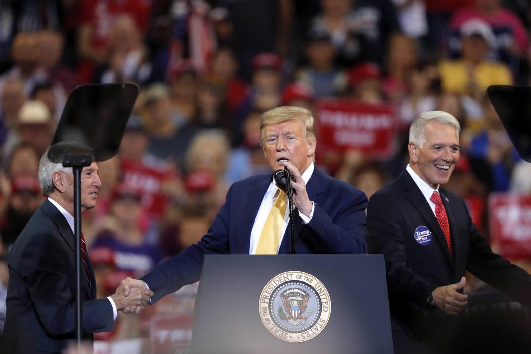 President Donald Trump greets Louisiana Republican gubernatorial candidates Ralph Abraham right ...