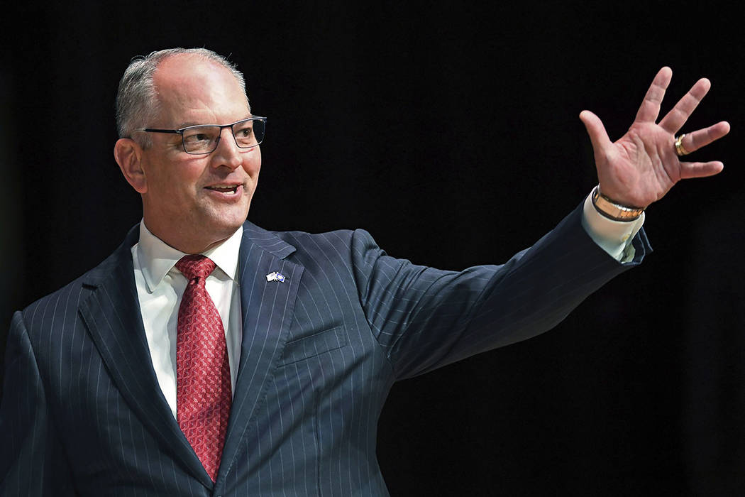 FILE - In this Sept. 19, 2019, file photo, Gov. John Bel Edwards acknowledges his supporters as ...