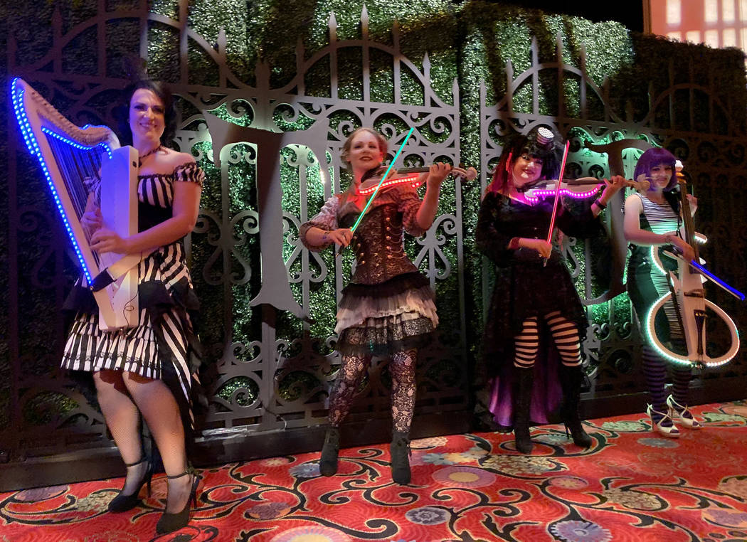 Members of Violectric from Orlando, from left, Madison Harding, Lexy Parsons, Michelle Jones an ...