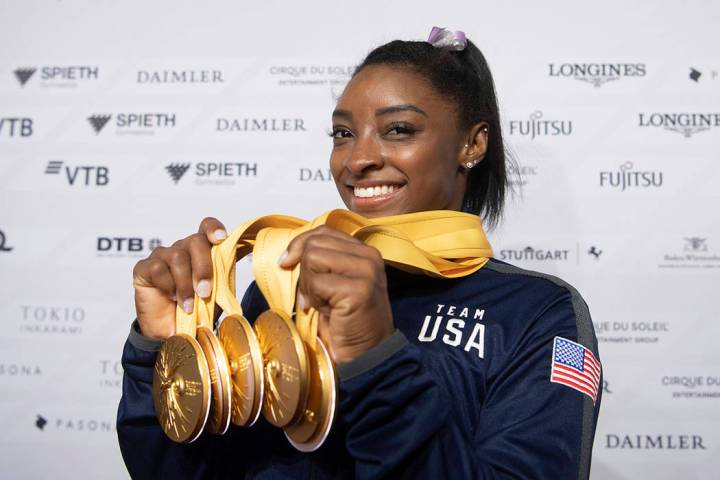Simone Biles of the United States shows her five gold medals at the Gymnastics World Championsh ...