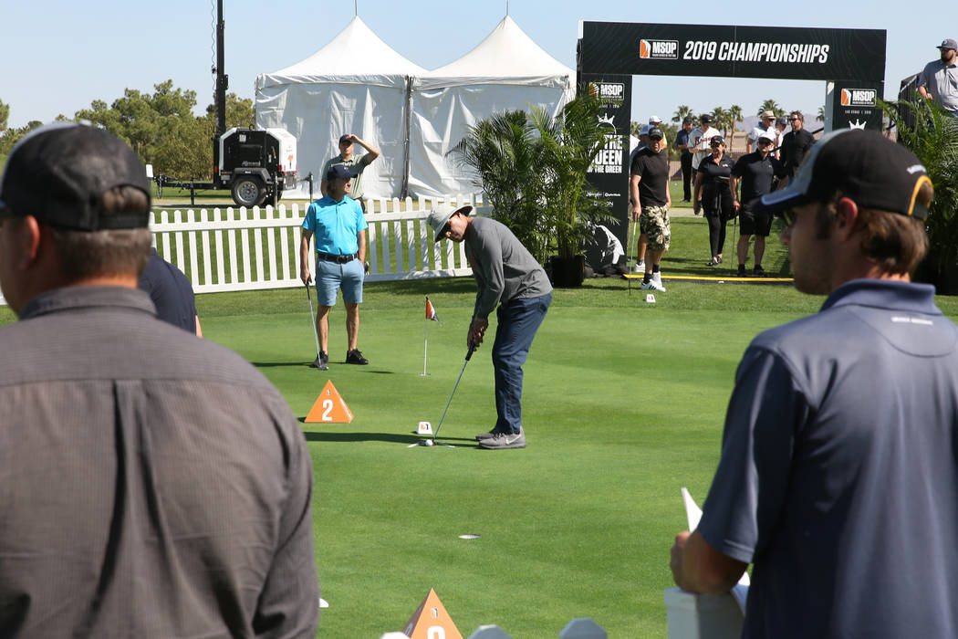 Mike Gonzales of San Diego, Calif., right, competes during the Major Series of Putting at Legac ...
