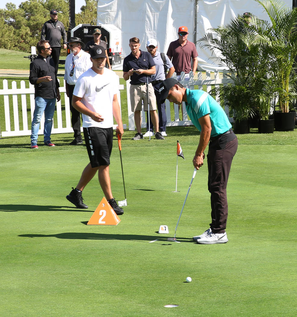 Matthew Marquez of Trinidad and Tobago, right, competes during the Major Series of Putting at L ...