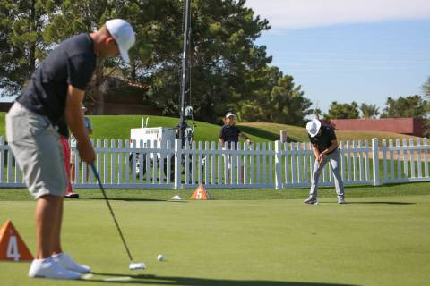 Taylor Montgomery, left, from Las Vegas and Jacob Stasiulewicz from Scottsdale, Ariz. putt in t ...