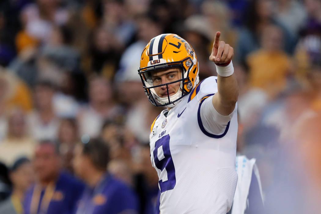 LSU quarterback Joe Burrow (9) warms up before an NCAA college football game against Florida in ...