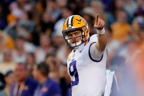 LSU quarterback Joe Burrow (9) warms up before an NCAA college football game against Florida in ...