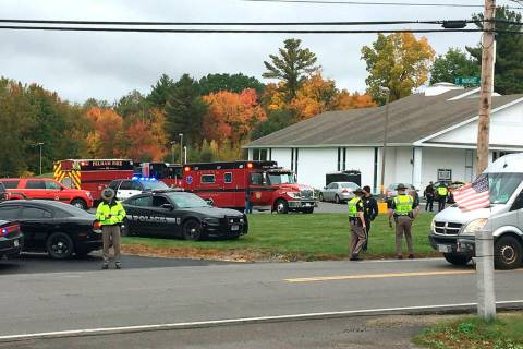 In this photo provided by WMUR-TV, police stand outside the New England Pentecostal Church afte ...