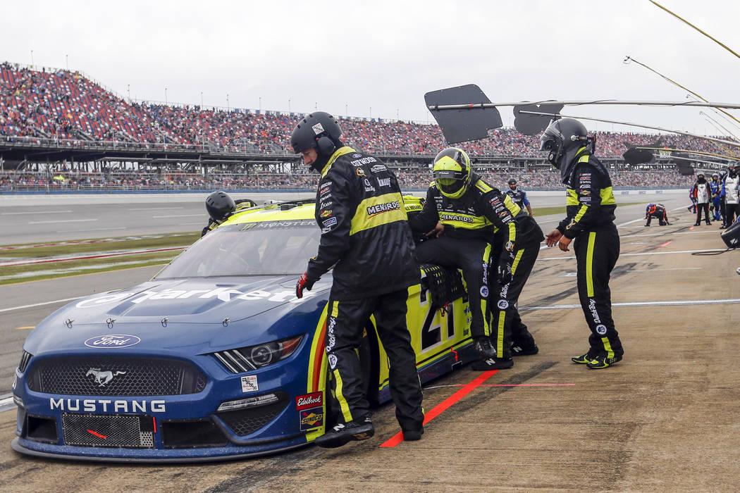 Paul Menard (21) climbs out of his car as Matt Crafton prepares to relieve him during a NASCAR ...