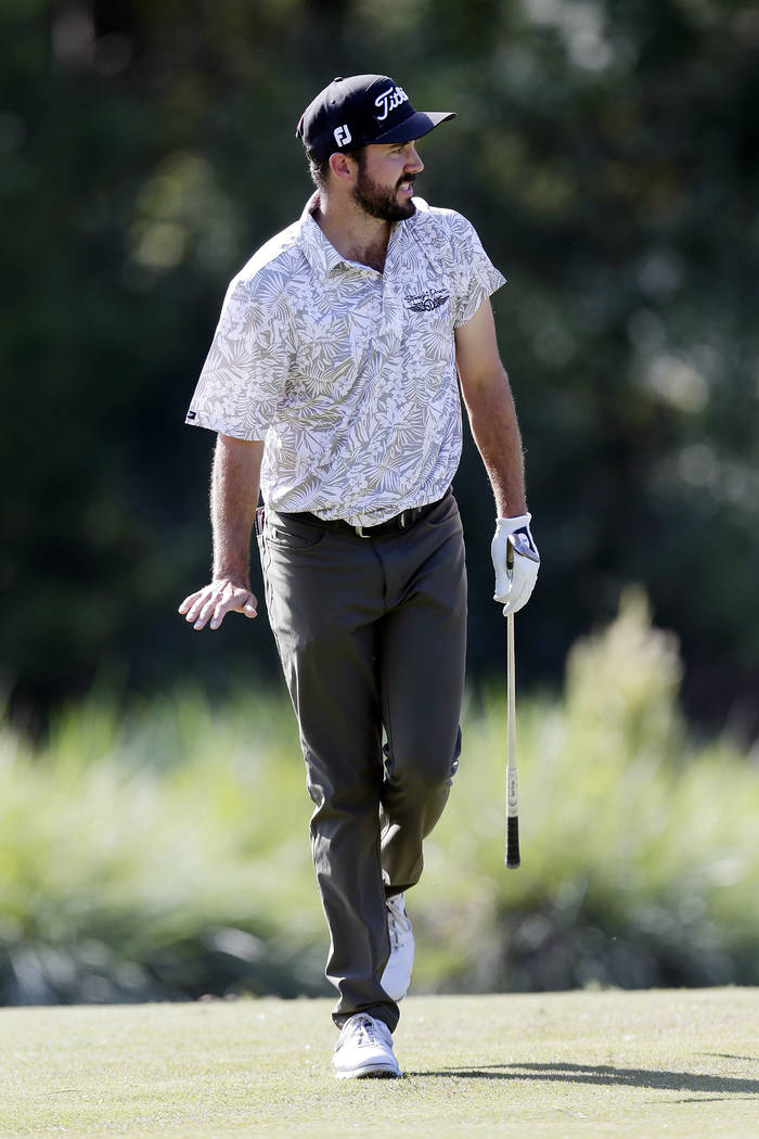 Mark Hubbard reacts as he watches his putts roll on the ninth green during the fourth round of ...